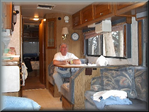 Dad sitting in the motor home