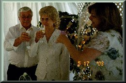 Barbara toasting the new couple